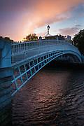 The Ha'penny Bridge (Irish: Droichead na Leathphingine, or Droichead na Life), known later for a time as the Penny Ha'penny Bridge, and officially the Liffey Bridge, is a pedestrian bridge built in 1816 over the River Liffey in Dublin, Ireland. Made of cast-iron, the bridge was cast at Coalbrookdale in Shropshire.