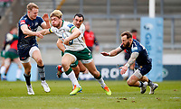 Rugby Union - 2020 / 2021 Gallagher Premiership - Round 4 - Sale Sharks vs London Irish - A J Bell Stadium<br /> <br /> Ollie Hassell-Collins of London Irish is tackled by Jean-Luc du Preez and Byron McGuigan of Sale Sharks at A J Bell Stadium<br /> <br /> Credit COLORSPORT/LYNNE CAMERON