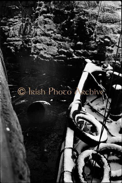 13/01/1963<br /> 01/13/1963<br /> 13 January 1963<br /> Snow scenes from Kiliney and Dun Laoghaire, Co. Dublin. View of boat in frozen water.