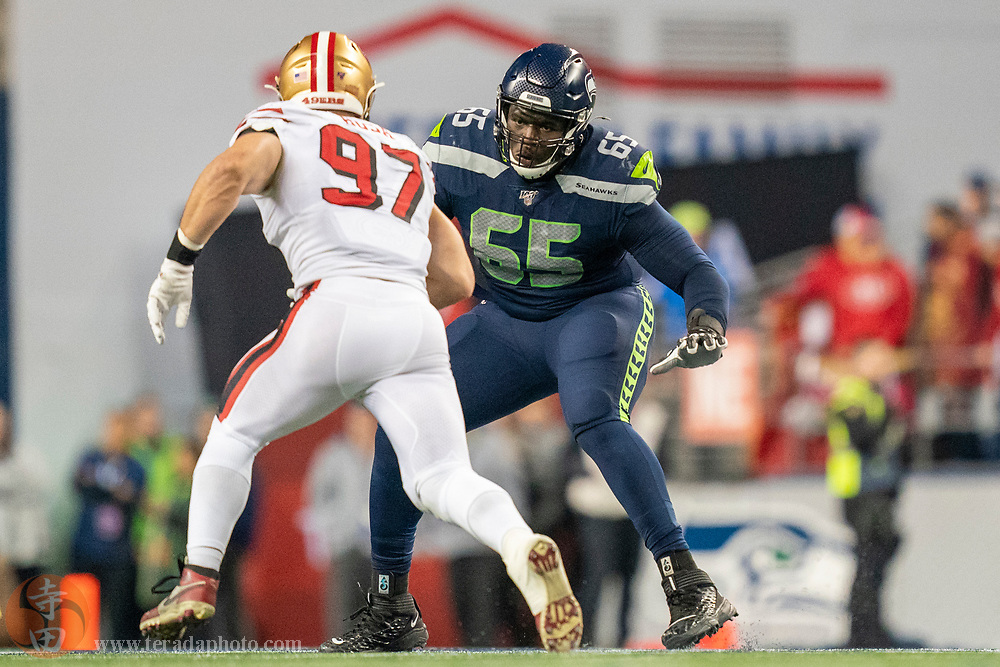 December 29, 2019; Seattle, Washington, USA; Seattle Seahawks offensive tackle Germain Ifedi (65) blocks San Francisco 49ers defensive end Nick Bosa (97) during the second quarter at CenturyLink Field.