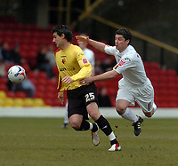 Photo: Leigh Quinnell.<br /> Watford v Luton Town. Coca Cola Championship. 09/04/2006. Lutons Steve Robinson launches a flying attack on Watfords Matthew Spring.
