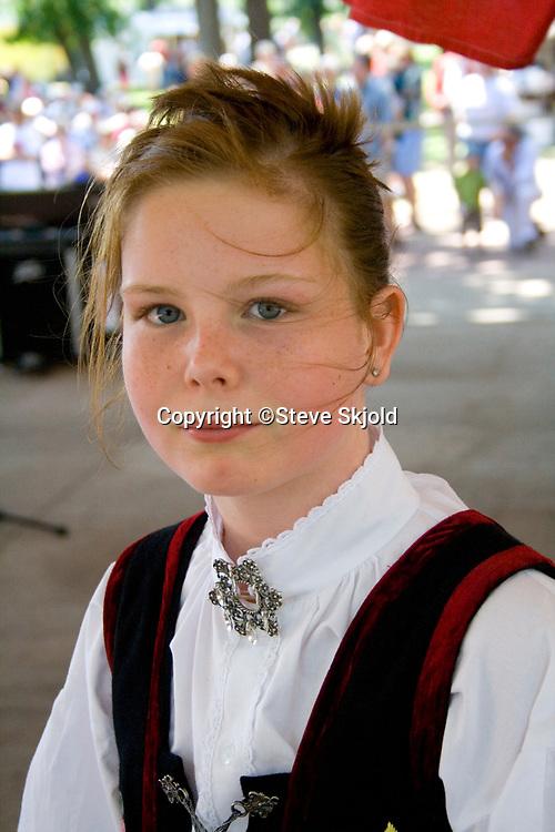 Attractive teen in Norwegian dress at Norway Day in Minnehaha Park. Minneapolis Minnesota MN USA