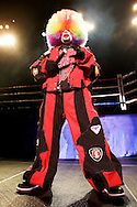 """Tommy Johnson, aka """"Tommy the Clown"""" is the father of Krumping and Clown dancing..Battlezone 2005 held at the Great Western Forum in Inglewood, CA. Krumpers and Clown dancers from South Central LA showcase their dancing skills in a yearly competition. Tommy Johnson, aka """"Tommy the Clown"""" started the Clown dance and Krumping movement in South Central LA as a real alternative to gangs and crime. The high energy Krumping and Clown dancing are hip hop based with African tribal dancing tributes. Face paint is often worn to distinguish the dancers unique dance styles, most are clown like with graffiti accents. The dance movement was made popular by the recent documentary """"Rize"""" by photographer David LaChappelle which featured """"Tommy The Clown"""".."""