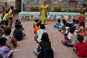 Children taking part in activities at the Kamatipura Centre in Mumbai. The centre welcomes about 100 children every day from the surrounding red-light district. The centre is run by the Prerana organisation who specialise in children of the red-light districts in Mumbai.