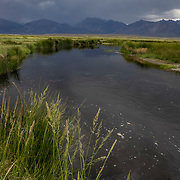 Weather moves in along the Upper Owens River with the Eastern Sierras serving as a backdrop.