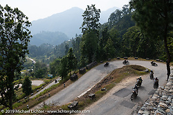 Riding through some twisty mountain curves on Motorcycle Sherpa's Ride to the Heavens motorcycle adventure in the Himalayas of Nepal. Riding from Chitwan to Daman. Tuesday, November 12, 2019. Photography ©2019 Michael Lichter.