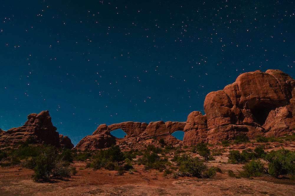 The famous North and South Window arches at 4am on an incredible moonlit night deep in the Moab Desert in Arches National Park in Eastern Utah.
