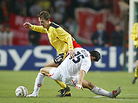23/11/2004 - UEFA Champions League - Group A - AS Monaco v Liverpool  - Stade Louis II, Monte Carlo<br />Monaco's Andreas Zikos gets tangled up with Liverpool's Dietmar Hamann<br />Photo:Jed Leicester/Back Page Images
