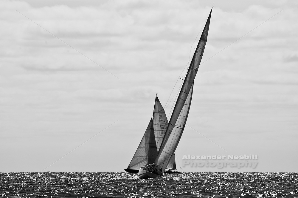 Newport RI, 2009 - 12 Meter World championships.  The pre start with a backlit cross of US 46 America II and US 22 Intrepid