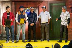 Mooneyes Shige Suganuma presents the Best of Show award to Heiwa Motorcycles for their custom Triumph at the 26th Annual Yokohama Hot Rod and Custom Show 2017. Yokohama, Japan. Sunday December 3, 2017. Photography ©2017 Michael Lichter.