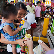 Food distribution in the Bacolod district of Manila. All the women have been to a workshop in the dangers of human trafficking first and now receive a basic food parcel with rice, dry soup, sweets and juice. Laura Vicuña is a non-profit charity working in Manila and in Bacolod in the state Negros Occidental in the Philippines.