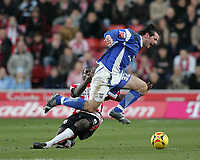 Photo: Lee Earle.<br /> Southampton v Ipswich Town. Coca Cola Championship. 21/01/2006. Darren Powell (L) slides in on Ipswich's Alan Lee.