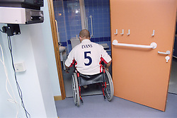 Young man; who is a wheelchair user; entering purposebuilt bathroom in bedsit at direct access hostel for homeless and vulnerably housed young people,