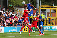 AFC Wimbledon defender Paul Kalambayi (30) winning header in box during the EFL Sky Bet League 1 match between AFC Wimbledon and Accrington Stanley at the Cherry Red Records Stadium, Kingston, England on 17 August 2019.
