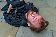 Climate and animal justice group, Animal Rebellion protestors laid down to perform 'Animal Extinction' after they presented an open letter to the UK Government on Tuesday, Sept 8, 2020. The letter, signed by a coalition of doctors, zoologists, NGOs, as well as climate and animal justice organisations, suggests that animal agriculture is a key driver in the emergence of deadly diseases and pandemics.<br /> Activists dressed in black-clad marched and held a funeral procession as part of the letter delivery outside Downing Street. (VXP Photo/ Vudi Xhymshiti)