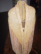 Jacket made of small gold beads<br />Paco Rabanne Exhibition Sept 25 to Nov 03, 2002 at<br />Galleria Carla Sozzani - Corso Como<br />Milan, Italy<br />For the first time in the history of fashion a designer mixes metal, plastic and paper<br />Photo By Celebrityvibe.com
