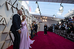 DeVon Franklin (L) and Meagan Good (R) arrive on the red carpet of The 91st Oscars® at the Dolby® Theatre in Hollywood, CA on Sunday, February 24, 2019.
