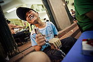 Laugh of a young vietnamese kid in a street of Hanoi, Vietnam, Southeast Asia