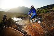 BMW motorcycle going through mud puddle at the 2009 Rawhyde Adventure Rider Challenge in Castaic, CA