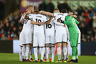 Swansea city players huddle ahead of k/o. EFL Carabao Cup 4th round match, Swansea city v Manchester Utd at the Liberty Stadium in Swansea, South Wales on Tuesday 24th October 2017.<br /> pic by  Andrew Orchard, Andrew Orchard sports photography.