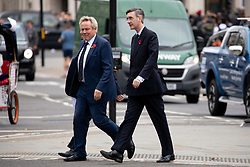 © Licensed to London News Pictures. 06/11/2018. London, UK. Jacob Rees-Mogg MP (right) arrives for a Service at St Margaret's Church, Westminster to mark the Centenary of the end of the First World War. Parliamentarians from the House of Commons and House of Lords gathered to remember the sacrifices of those parliamentarians, parliamentary officers and staff who gave their lives during the First World War, or who were injured. Photo credit : Tom Nicholson/LNP