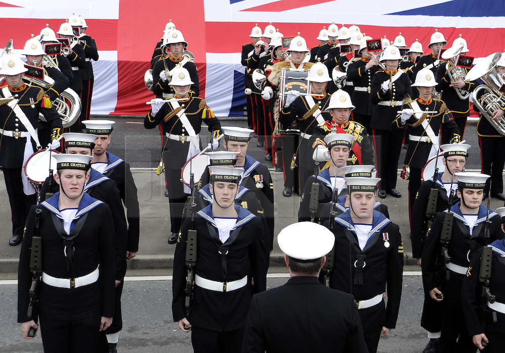 © under license to London News Pictures. 12/02/2011. The crew of HMS Chatham march through the ships home town of Chatham, Kent town for their farewell parade. The Strategic Defence and Security Review revealed the Royal Naval frigate would be withdrawn from service. The ship's company were joined by the Band of the Royal Marines for the Freedom of the Borough parade. Picture credit should read: Grant Falvey/LNP