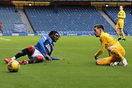 Josh Mullin (Livingston) tackles Calvin Bassey (Rangers) during the Scottish Premiership match between Rangers and Livingston at Ibrox, Glasgow, Scotland on 25 October 2020.