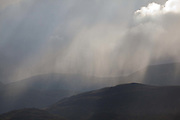 The Highland hills above Kingussie, Scotland. The summer weather brings rain as well as sunshine.
