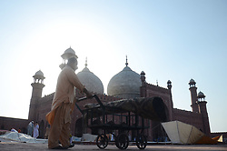 June 26, 2017 - Lahore, Punjab, Pakistan - Pakistani worker busy in preparation of Eid al-Fitr prayer at historic Mughal era Badshahi Masjid in Lahore. Eid-ul-Fitr is an important religious festival celebrated worldwide by Muslims with great zeal and enthusiasm. Eid al-Fitr ''feast of breaking of the fast'' is an important religious holiday celebrated by Muslims worldwide that marks the end of Ramadan, and first day of Shawwal according to Islamic Hijri cleaner. (Credit Image: © Rana Sajid Hussain/Pacific Press via ZUMA Wire)