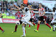 Swansea city's Michu has a shot at goal. Barclays Premier league match, Swansea city v Sunderland at the Liberty Stadium in Swansea, South Wales on Saturday 19th Oct 2013. pic by Andrew Orchard, Andrew Orchard sports photography,