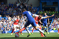 Santi Cazorla, the Arsenal tackles Oscar of Chelsea. Barclays Premier League match, Chelsea v Arsenal at Stamford Bridge in London on Saturday 19th September 2015.<br /> pic by John Patrick Fletcher, Andrew Orchard sports photography.