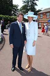 MR JOHN & LADY CAROLYN WARREN at the King George VI and The Queen Elizabeth Diamond Stakes sponsored by De Beers for the 33rd year held at Ascot Racecourse, Berkshire on July 24th 2004.