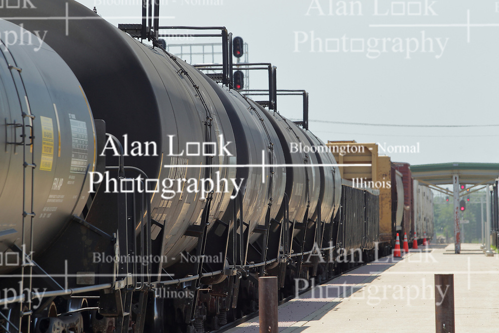 A freight train pulling boxcars and tankers travels past the Amtrak Depot in Galesburg Illinois