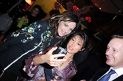 Left to right, MARTHA FIENNES and LI QUAN founder of Save China's Tigers at a private view of her work entitled 'Martha Fiennes' held at Shanghai Tang, Sloane Street, London on 9th February 2010.