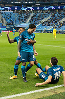 SAINT PETERSBURG, RUSSIA - DECEMBER 08: Malcom [left] and Aleksei Sutormin [ground] celebrate after Sebastián Driussi [centre] opens the scoring for Zenit St. Petersburg during the UEFA Champions League Group F stage match between Zenit St. Petersburg and Borussia Dortmund at Gazprom Arena on December 8, 2020 in Saint Petersburg, Russia. (Photo by MB Media)