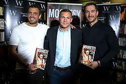 """© Licensed to London News Pictures . 09/07/2016 . Manchester , UK . Actor JAMIE LOMAS , boxer JAMIE MOORE and actor ANTHONY QUINLAN at a book signing for Jamie Moore 's book """" Mooresy """" at Waterstones on Deansgate in Manchester City Centre . Photo credit : Joel Goodman/LNP"""