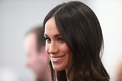 Meghan Markle smiles as she attends a reception with delegates from the Commonwealth Youth Forum at the Queen Elizabeth II Conference Centre, London, during the Commonwealth Heads of Government Meeting.