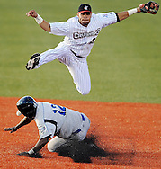 Crushers shortstop Jodem Rivera leaps over Windy City base runner Gilberto Mejia while turning a double play last night in the third inning. DAVID RICHARD / CHRONICLE