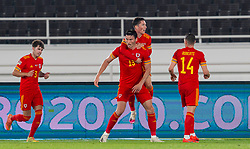 HELSINKI, FINLAND - Thursday, September 3, 2020: Wales' Kieffer Moore celebrates with team-mate Harry Wilson after scoring the only goal of the game during the UEFA Nations League Group Stage League B Group 4 match between Finland and Wales at the Helsingin Olympiastadion. Wales won 1-0. (Pic by Jussi Eskola/Propaganda)