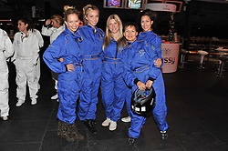 Left to right, MARISSA HERMER, NOELLE RENO, JESS PENNACHETTI, GULNIDA TOICHIEVA and DEE VESALI at a Girl Karting - a charity Go-Karting evening in aid of Too Many Women held at The Raceway, 3 Herringham Road, London SE7 on 12th September 2012.