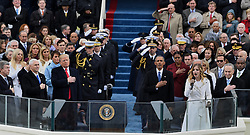 President Donald Trump and ex-President Barack Obama listen to the National Anthem sung by 16-year-old Jackie Evancho at the end of the Inauguration Ceremony on January 20, 2017 in Washington, D.C. Trump became the 45th President of the United States. Photo by Pat Benic/UPI