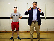 25 APRIL 2019 - DES MOINES, IOWA: JROTC student HUNTER TROGDON, left, stands next to US Representative SETH MOULTON (D-MA), while Moulton talks to a JROTC class about public service, including military service, at Central Academy. Rep. Moulton visited Central Academy in Des Moines Thursday to talk to high school students and the school's JROTC class about public service. Moulton, a US Marine veteran who served in Iraq, is running to be the Democratic candidate for the US Presidency in 2020. Iowa traditionally hosts the the first selection event of the presidential election cycle. The Iowa Caucuses will be on Feb. 3, 2020.          PHOTO BY JACK KURTZ