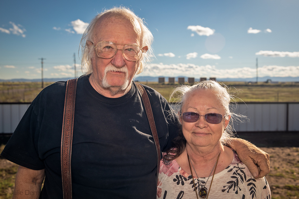 The Sue and James Franklin in front of their home in Verhalen, with a fracking industry site directly across the road from them.