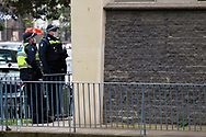 Police are seen guarding the Sutton Street housing commission towers amid the third full day of the total lockdown of 9 housing commission high rise towers in North Melbourne and Flemington during COVID 19.After recording 191 COVID-19 cases overnight forcing Premier Daniel Andrews to announce today that all of metropolitan Melbourne along with one regional centre, Mitchell Shire will once more go back to stage three lockdowns from midnight Wednesday June 8. This comes as the residents of the housing commission towers in North Melbourne and Flemington finish their third day under extreme lockdown, despite only 27 cases being found in the towers. Members of the public gathered outside of the towers this afternoon in support of those trapped inside while riot police arrested two women for standing too close to the fence. While the women were later released, tensions are boiling over both in the towers and out. With 772 active cases in Victoria, NSW closed their border to Victoria effective at midnight tonight.
