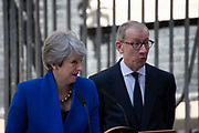 Prime Minister Theresa May and her husband Philip May react to protesters shouting Stop Brexit during her outgoing statement  at Downing Street on 24th July, 2019 in London, United Kingdom. Today she makes her final statement as Prime Minister of Great Britain and Northern Ireland before formally tendering her resignation at Buckingham Palace. Boris Johnson takes charge at 10 Downing Street later today.