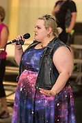 Antares J. Barr sings the national anthem prior to the roller derby bout between Hades Ladies and the Susquehanna Valley Derby Vixens.