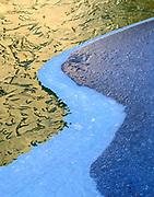 Three Layers of Ice Patternsin the Merced River,Yosemite National Park, California