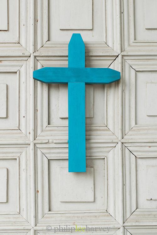 Blue cross in church on Chiloe Island, Chile. Church of Nuestra Señora de Gracia de Nercón.
