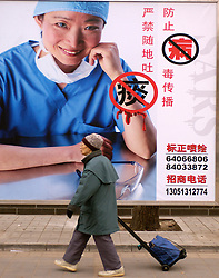 Government billboard in Beijing warnng against spitting in public