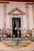 A balcony and colorful building in the historic center of Guanajuato City, Guanajuato, Mexico.
